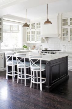 Traditional kitchen styled with center island and marble countertops