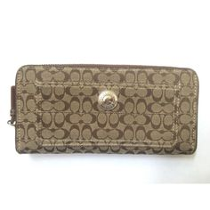 Authentic Coach Monogram Wallet Continental zip around  12 card holder slots Zip closure pocket inside Gently used Let me know if you have any questions!  Coach Bags Wallets