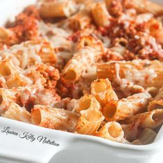 The Easiest Baked Ziti Recipe Main Dishes with pasta, lean ground turkey, olive oil, onions, garlic, crushed tomatoes, tomato sauce, basil, ground oregano, salt, shredded mozzarella cheese, grated parmesan cheese