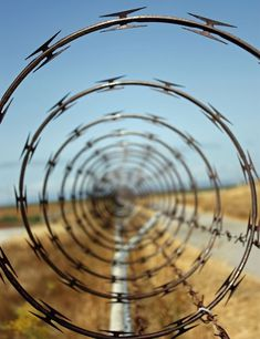 Repetition: This barb wire is an example of repetition, because you can see the same spiral all the way through the photo. Repetition is when something is repeated. Other elements in this photograph are, black and white, spiral, and leading lines. Motion Blur Photography, Types Of Photography, Abstract Photography, Creative Photography, Photography Ideas, Symmetry Photography, Apples Photography, Levitation Photography, Experimental Photography