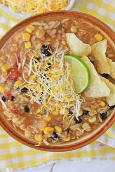 Instant Pot Mexican Chicken and Rice Soup served in a brown bowl, topped with lime slice, chips and shredded cheese Slow Cooker Recipes, Cooking Recipes, Easy Recipes, Soup Recipes, Chicken Recipes, Easy Family Dinners, Family Meals, Family Recipes, Make Ahead Meals