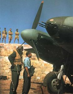 Pilot and navigator in front of a Mosquito Mk.NFII (nightfighter), in a pen at Luqa (Malta).