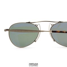 8c10406100 The MATSUDA EYEWEAR    M3036 is a modified aviator shape with a floating  high arched bridge crafted out of Japanese titanium. The temples of the  M3036 are ...