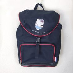 Hello kitty backpack FRENCH HELLO KITTY BACKPACK!! Authentic circa 2002. never used but has gotten a few scratches on the bottom from storage:( ! Backpack has a drawstring close with one single buckle to close. Hello Kitty Bags Backpacks