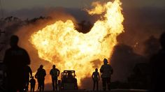 A massive fire roars through a mostly residential neighborhood in San Bruno, Calif., on Sept. 9, 2010. Just months after a deadly pipeline explosion near San Francisco, a California utility quietly disclosed that its ruptured line had sprung a gas leak in a spot only a few miles away years before.