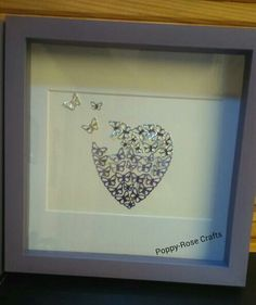 Butterfly heart in purple shades fading out to silver at the top. In a purple frame. Made by me! Poppy-Rose Crafts on facebook 💜