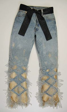 Beaded jeans with black tie belt, by Jean Paul Gaultier, French, 1996-2000.