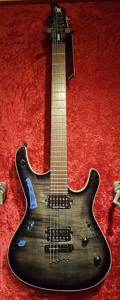 Mayones Setius 6 GTM also in Graphite Black but with a Flamed Maple Top. Seymour Duncan SH-2 Jazz (neck) + TB-4 JB (bridge)