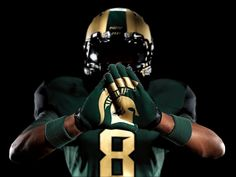 "After much anticipation, Nike and MSU unveiled the Pro Combat uniforms the Spartans will wear against Michigan on Oct. 15 at Spartan Stadium.    In a press release with the subhead ""True Warriors of Battle"" sent out by the university Monday, the MSU football team is compared to the Spartan warriors of Ancient Greece. The uniforms play off of that idea with Bronze helmets, accents and numbers to go along with the green and black jerseys and pants. There is not a hint of white in th..."