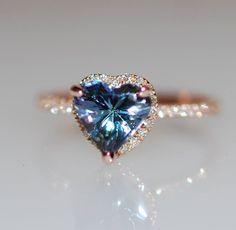 Heart engagement ring Tanzanite ring by Eidelprecious This ring will definitely steal her heart :) #wedding #weddinginspiration #DazzlingDiamondEngagementRings
