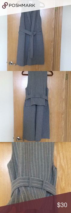 C/MEO Collective belted vest. C/MEO Collective belted vest. Heavy weight pinstriped fabric. Long front with short back. Reposhing from another seller as the vest just isn't me. C/MEO Collective Jackets & Coats Vests