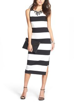 Absolutely loving this thick black-and-white striped midi dress for a chic going out look when paired with a clutch and statement necklace.
