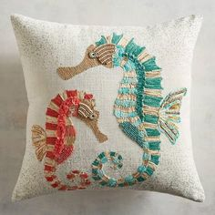 Our pretty pair of seahorses is what ocean dreams are made of. Decked out in turquoise and coral on a neutral background, these steeds will add a coastal vibe to your sofa, bed or chair. Embroidery Applique, Embroidery Stitches, Embroidery Designs, Applique Cushions, Coastal Bedrooms, Decorative Throw Pillows, Cross Stitch Patterns, Needlework, Creations
