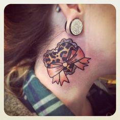 Leopard heart + bow tattoo