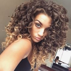 Natural texture curly hair balayage