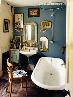 ♥ the dark blue walls, clawfoot tub, antique mirrors