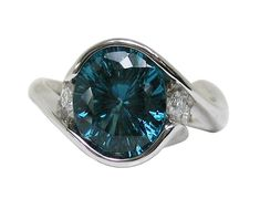 Blue-green tourmaline and diamond ring in palladium by artist Tom Dailing.