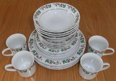 """Gibson 32 piece Holly Berry gold rim China set with 5-piece serving set. 8 each: (4 shown in picture to fit) dinner plate salad/dessert plate soup bowl 3"""" mug  Serving set includes: 12"""" platter, two serving bowls and salt/pepper shakers. One bowl has small chip.  Used twice (for 2 Christmas meals). Not microwave safe, hand washed. $50 plus shipping"""