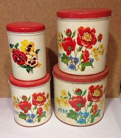 Vintage nesting nesting Parmeco floral canisters with red lids from the Parker Metal Company, Baltimore, MAryland.