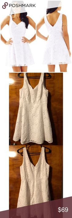 """Lilly Pulitzer Marla V-Neck Eyelet Dress Beautiful white Lilly dress with no stains or rips. It looks new. I bought off of here and it fits great, just a little shorter than my liking. I'm asking the exact same price I paid for it. 19"""" from waist line to hem, and 20"""" armpit to armpit laying flat. Any questions please ask! Lilly Pulitzer Dresses Midi"""