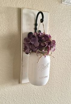 This is a 14 tall and 5.5 wide mason jar Sconce with a Quart sized Mason jar. You can choose your Flower color, Sconce finish, and Mason Jar Color. You will choose your Finish at checkout and you just leave me a note in the notes to seller box at checkout with your Jar and Flower color choices. Scroll through the listing to see all of your customization options.  {Pic 1 shows an Espresso Sconce, Antique White Jar and Lavender Hydrangea} (Pic 2 shows an Antique White Sconce, Antique White Jar…