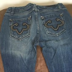 """ReRock for Express jeans Boot cut low rise. These have been hemmed to a """"regular"""" length. I'm 5'6"""" and these are ling enough to wear with flats. They look more like straight leg than boot cut. Rerock Jeans Straight Leg"""