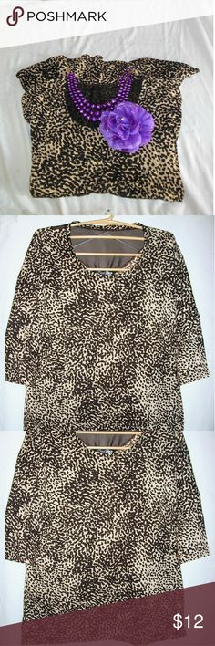 Leopard Print 3/4 Sleeved Top Size 22/24 Up for your consideration here is a leopard print shirt made by Lena V in a size 22/24. Around the neckline in the back there is a sheer piece, and in the front along the neckline there are  gunmetal colored stud pieces. Please note that any objects photographed with this shirt are not included. Do you have any kiddos or someone special in your life? Make sure to bundle by adding another item to receive 10% off! Lena Tops Tees - Long Sleeve
