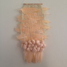 woven wall hanging / weaving with feathers by Maryanne