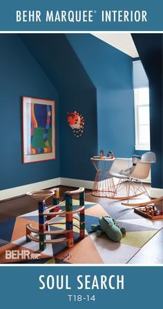 The dark blue hue of Soul Search by BEHR Paint pairs perfectly with the bright accent colors in this kid's playroom. BEHR MARQUEE® Interior Paint is designed to cover in one-coat, guaranteed in over 1000 colors, making your new room transformation easier than ever! Check out the Behr Marquee One-Coat hide color palette to find the hue for you.