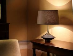 Wood Tavolo S Italian table lamp shown in oak wood. Table Lamp made with different materials: brass polished nickel finish and oak wood wenge finish. Lampshade in cotton-linen available in two different colors. Table Lamp available in 3 sizes. Made in Italy.
