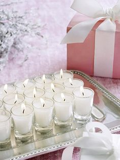 candles on a silver tray