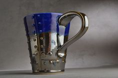 Sheet Metal Mug Made To Order Blue and Chrome Sheet Metal Stoneware Mug by Symmetrical Pottery. $25.00, via Etsy.