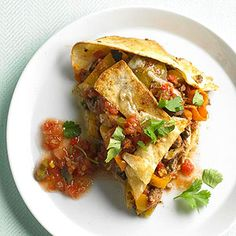 This Mexican casserole tastes just like tacos, but without all the single-serving fuss. Just layer your favorite ingredients between flour tortillas and bake.