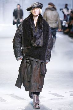 9. John Galliano Fall 2008 Menswear; This look is a modern take on a King's outfit during the Northern Renaissance. He's got a hat reminiscent of a king's as well as the fur trimmed coat.