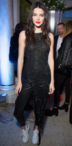 Kendall Jenner joined in on the celebrations at the Editorialist spring/summer 2016 issue launch party, in which mom Kris was honored, in a look that can be best described as glam athleisure—a shimmery asymmetric black dress, complete with model off-duty extras, aka black leggings and Adidas Superstars.