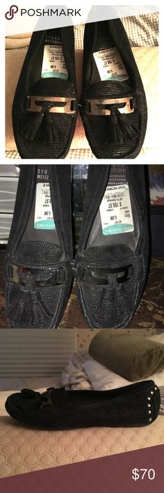Loafers Black leather loafers w/shiny detail on leather when light catches it. Tassels on front. Stuart Weitzman Shoes Flats & Loafers