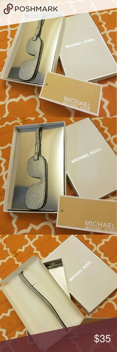 Michael kors silver leatger charm 100% authentic Michael kors silver saffiqno leathet sunglasses style bag charm or key charm. Got 12 of them last Christmas from my hubby so I'm selling things that I haven't used or not using.   Very unique and gorgeous piece to add on your bag or keys. I Also have different style and colors listed in my closet. Check it out. Michael Kors Accessories Key & Card Holders