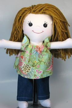 All handmade with embroidered face....cute! Reminds me of my niece! lol