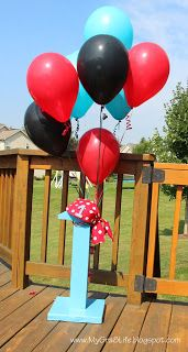 1st Birthday Pirate Party - wooden number one with balloons and pirate hat