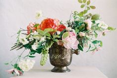 Cascading Flower Arrangement in Silver Vase by Amy Osaba Event.Floral.Design | photography by http://www.ryleehitchnerphotography.com/