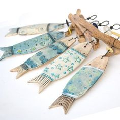 ceramic fish and driftwood hangers by Shirley Vauvelle available at… Fish Crafts, Beach Crafts, Clay Crafts, Ceramic Clay, Ceramic Pottery, Deco Marine, Clay Fish, Driftwood Crafts, Driftwood Fish