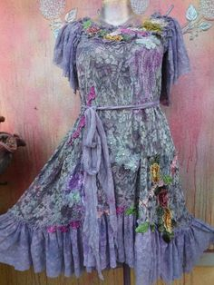 these unique pieces are works of art,labors of love and a gift to lovers of etsy!!! shes a wonderful bohemian lilac lace dress sprayed over in blue and pale crimson then kissed with assorted laces,butterflies,leaves,crochet,bridal laces and shabby roses then crushed my style to add to her old world charm... based on stretch lace with long lace ties at the sides she will suit from a smaller to firmer 40 chest...... dips from front to back and from top of shoulders down measures 35 to 40.. a…