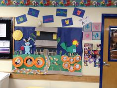 Infant Halloween bulletin board. Haunted house by teachers. Candy corn feet, frankenfeet, pumpkins, and owls by the infants!