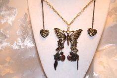 This beautiful necklace is on sale at http://artbymichelewilson.com/sellsteampunkelusivebutterflyoflove.htm