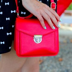 """{H&M} Mini Red Satchel Bag Petite and vibrant mini red crossbody satchel bag.  Worn once.  So cute!  Adds a perfect pop to any outfit.  6"""" length, 5"""" width, 2.5"""" depth, 18"""" strap.  Holds phone, mini wallet, makeup, keys, and small essentials! H&M Bags Mini Bags"""
