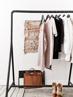 LE FASHION BLOG HOME DECOR IDEAS OPEN CLOSETS PART 2 FASHIONABLE HOME INSPIRATION CLOTHES ON DISPLAY EXPOSED BRICK MINIMAL CLASSIC BLACK NU...