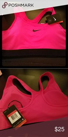 NWT Hot pink Nike sports bra This Nike sports bra is brand nwt. Given as a gift, but a  tiny bit too big. I'm a 32DD and it is loose around the band - meant more for 34-36D and up. Removable pads and medium support. First pic shows off hot pink color the best. Nike Intimates & Sleepwear Bras