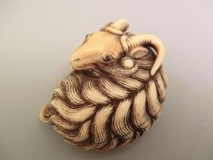 Netsuke ~ Carved and stained ivory