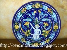 Il piatto ornamentale con il putto #Majolica #Italy http://ceramicamia.blogspot.it/2011/05/il-piatto-ornamentale-con-il-putto.html