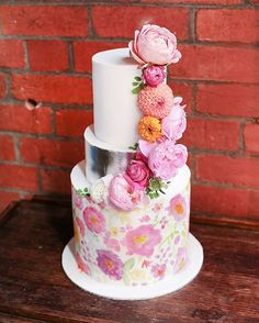 pink watercolor wedding cake with flowers